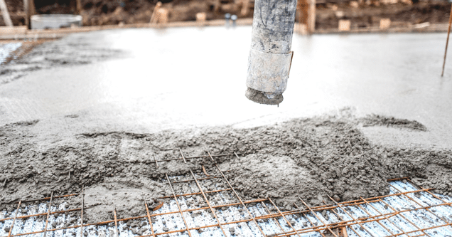 close up of steel mesh being filled with concrete