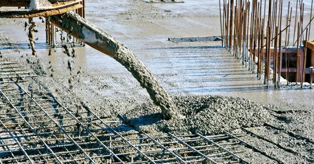 concrete being poured on top of rebar